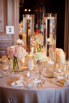 White flowers and candles go perfectly together | Michelle VanTine Photography | Brides.com