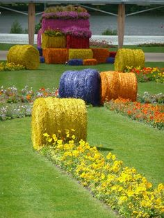 Multicolored straw bales and carpet of flowers at the International Floralies of Nantes - Paris garden side - Multicolored straw bales and spring flowers, creation SEVE Nantes, International Floralies, Nantes -