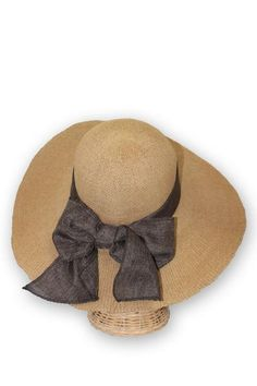 71a84c4b25c UPF 50 straw derby hat with a Southern flair. Great for the summer derby or  your next vacation. Feminine bow accent in the back and sizing drawstring.