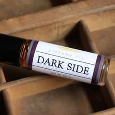 Dark Side Perfume Oil - We all have a dark side, some of us are just a little better at admitting it! This one smells like black currant, star anise, cedar, clove, patchouli, and smoky vanilla. Go ahead, let it all out.