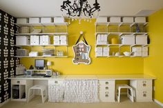 Great craft room idea! I like the fabric below the desk and the mirror