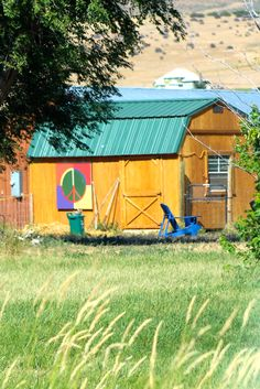A peace sign on a small barn/ shed