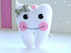 'Loose Tooth?' Tilly the Tooth Fairy Pillow will keep your wee ones tooth safe till the tooth fairy arrives. Hang her from the door or bedhead by the ribbon loop or tuck her under a pillow. The pocket on her behind is perfect for storing that special tooth and keeping money safe once the to...