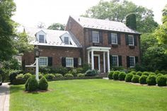 A classic. Brick colonial with a slate roof. Nicely landscaped too. Nice.