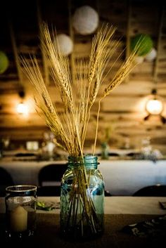"""mason jars are a 'go to', but I love the 'wheat'...maybe mixed with some fresh flowers down the tables??  It just screams """"Fall""""!!  (as in, the season, not 'fall down'!!)"""