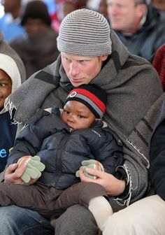 Pin for Later: See Prince Harry's Evolution From Cute Kid to Dashing Prince  Harry joined hands with a little boy during a visit to a children's center in  Semonkong, Lesotho, in June 2010.