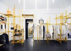 Golden aluminium framework features in Troquer fashion showroom by Zeller & Moye