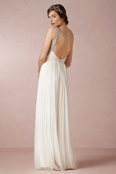 simple, elegant, open back gown, don't like the loose string and bow though