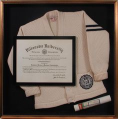 Tell a story about your college career by adding objects like tassels, honor cords, photos or clothing. Here is a college degree from 1971 displayed in a shadowbox with their letterman sweater and the original mailing tube. Designed and framed at Bradley's Art & Frame.