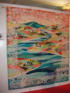Gorgeous white applique border overlaying this scenic quilt.