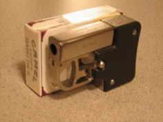 Downsizer WSP (world's smallest pistol) chambered in .357/.38 and .45 ACP. Double action single shot smoking kills