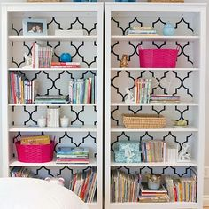 Cover the back of your bookcase with fabric or paper...Voila! So simple and so pretty!