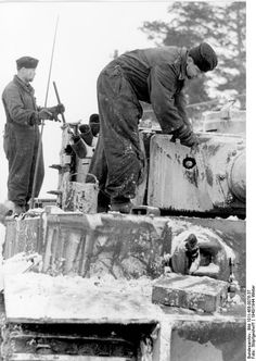 German tank crew paining their Tiger I heavy tank white for camouflage, Russia, winter of 1943-1944