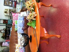 Orange distressed coffee table @ PrissyDoodles on Facebook.  I have one just like this, just need to paint it!  Love the color.
