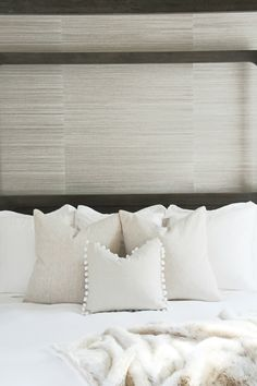 neutral bedroom décor | wood canopy bed | metallic lamp base