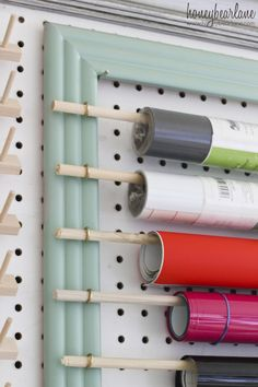 Craft Room Organizational Pegboard Picture frame hooks & dowel rods What a great way to store contact & wrapping papers. The post Craft Room Organizational Pegboard appeared first on Paper Diy.