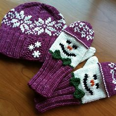 This design started by purchasing a cute set of buttons, and went from there! The hat features a wide ribbed brim with a seed stitch overlap which provides a place to sew those cute buttons. The crown of the hat has a classic stranded snowflake design. The mittens feature a wide ribbed cuff and gusset thumb. The snowmen on the mittens have happy duplicate-stitched faces, and are wearing hats that match the big hat.