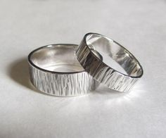His and Hers Bands, Wood Grain Wedding Rings Set. $70.00, via Etsy.