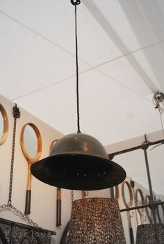 Army helmet pendant light by Antiques by Design. Found at Decorex. London Design Festival.