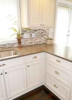 Small Kitchen Remodeling kitchen cream of white and glazed cabinets, small mosaic tile backsplash and dark wood floors with brown quartz countertops Oak Kitchen Remodel, Kitchen Cabinets, Kitchen Remodel, Kitchen Remodel Small, New Kitchen, Kitchen Dining Room, Home Kitchens, Kitchen Renovation, Kitchen Design
