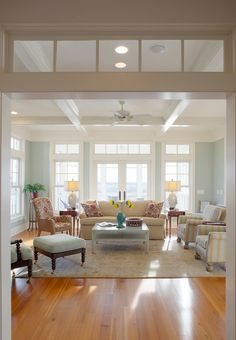 Transom windows don't need to stand out in order to be fabulous. Treat them as part of the entire window (or door) by using the same trim color all the way around.