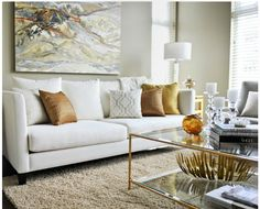 Contemporary Living Room With White Modern Sofa Paired With Copper Pillows,  Gold Pillows, Gray Greek Key Pillows And White And Gold Trellis Pillows.