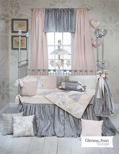 Elegance redefined. Richly embroidered floral, pastel pink moiré, warm cream velvet, woven plaid and satin bows accent this beautiful collection. Crushed taffeta bed skirt cascades dramatically to the nursery floor. Hand patched quilt and bumper are trimmed with delicate looped ribbon cord.  An exquisite choice for todays discerning tastemaker.