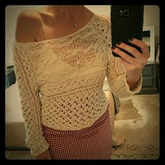 Free People Sweater I am selling the cutest, sexiest Free People cropped sweater.  It features an open knit, crochet design.  I can easily pull this off one shoulder to create a slouchy feel.  Perfect condition! Free People Tops Crop Tops