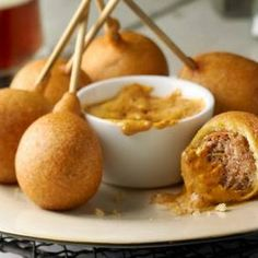 Italian Sausage Lollipops: Corn breading and sausage on a stick! I want a bite!