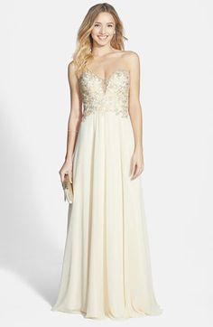 Free shipping and returns on FAVIANA Embroidered Chiffon Gown at Nordstrom.com. This gown's shapely sweetheart bodice is left seductively sheer at the décolletage and back, making a nice contrast against the many demure, embroidered flowers blossoming across it.
