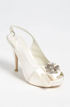 """Menbur Slingback Pump available at #Nordstrom    A sparkling starburst of crystallized cornucopias steals the spotlight on a satin slingback pump perfected with a partially concealed platform.        Approx. heel height: 4"""" with 1/2"""" platform.      Adjustable strap with buckle closure.      Satin upper/leather lining/synthetic sole.      By Menbur; imported.      Women's Shoes."""