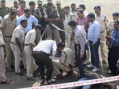 Police investigate the encounter site at the hillocks of Acharpura village after the STF killed 8 SIMI activists, who escaped from central jail after killing a security guard in Bhopal.