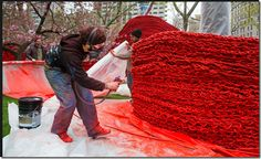 """Orly Genger's art installation called """"Red, Yellow and Blue"""" (2013)in Madison Square Park, New York-more than 1.4 million feet (430,000 meters) of painted, hand-knotted rope"""