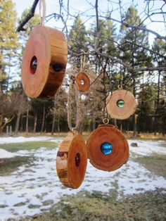 boy scout outdoor hanger:  wood slices with marbles in drilled holes