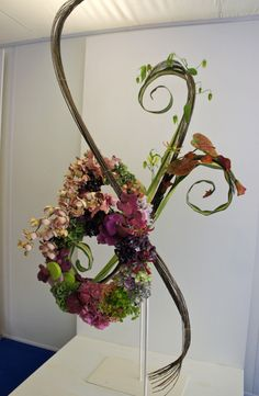 Contemporary Floral Art using Sculpture technic and artificial materials as well as fresh flowers | Chelsea flower show london 2012 floral design arrangement
