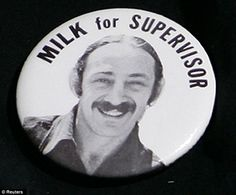 Barriers: Harvey Milk's first campaign button, when he ran for a seat on the San Francisco Board of Supervisors in 1973, is worn by a guest as she arrives for the Los Angeles premiere of the film 'Milk' at the Academy of Motion Pictures Arts and Sciences in Beverly Hills, California November 13, 2008. The movie is about Harvey Milk, California's first openly gay elected official
