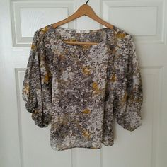 Semi sheer floral top. This top has mustard yellow, cream and grey. Rumors Tops