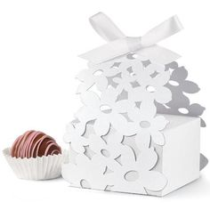 Beautiful, intricate favor boxes add a touch of elegance to any event or party. Each package includes 24 of each: boxes, wraps, ribbons and printable tags. Box measurements are approximately 1.5 in. x 2.5 in. x 2.5 in. and feature paper flowers on the boxes.