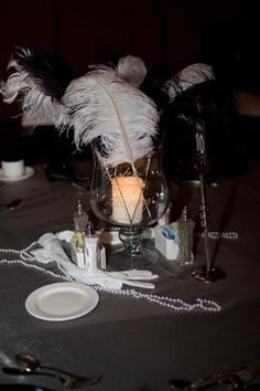 Great Gatsby centerpieces (feathers, gloves, pearls)