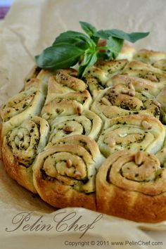 Basil pesto rolls - press out crescent roll dough, spread pesto, roll up into a log. Slice and place in a pie plate like cinnamon rolls.