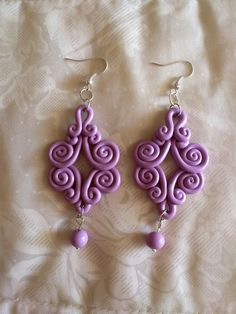 Pretty scrolled earrings from polymer clay by Victoria Holgado.