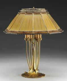A marvelous Tiffany Linenfold table lamp with a rare candelabra base and formed glass panels that Tiffany created that give the illusion of fabric | JV