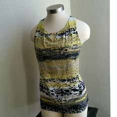 DANA BUCHMAN. ..BEAUTIFUL  BLACK YELLOW..TOP ...EXCELLENT CONDITION  ...LIKE NEW ...NO FLAWS ...BEAUTIFUL  ...A MUST HAVEEE  ...true to its size and color ...color...multiple ...2 pic up close ...design throughout  ...color block style ...Deco on front ...dull gold stud accent  ...comfortable  ...MTRL...adding soon ...better in person Dana Buchman Tops Blouses