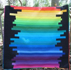 Anna's Rainbow quilt - I love it. The concept is simple but dramatic. Black does such wonderful things for other colors.