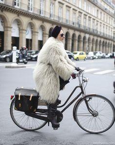Catherine Baba rides a bike.