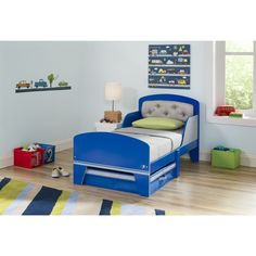 Ideal for any child's room, the Jack and Jill Blue/ Grey Toddler Bed with Upholstered Headboard has a fun and spunky style. This bed is made to fit your child's personality with its blue and grey design. Constructed from MDF, wood and polyester.