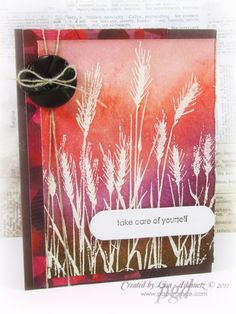 """By Lisa Adametz. Uses Hero Arts """"Silhouette Grass"""" stamped in white pigment ink on white cardstock panel & embossed in clear powder. (You could stamp in VersaMark & emboss in white powder.) Background sponged with Distress Inks. Panel layered on designer paper. Linen thread, button, & sentiment added. All attached to brown card base."""