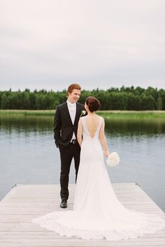 Real wedding in Finland. Lace dress with V-neckline and open back by Pukuni (www.pukuni.fi).