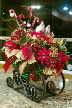 Ideas for Christmas Centerpieces come from a number of unique sources. Elf Christmas Decorations, Christmas Lanterns, Christmas Centerpieces, Christmas Tabletop, Christmas Flower Arrangements, Christmas Flowers, Christmas Wreaths, Christmas Sleighs, Theme Noel