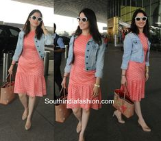 Tamanna Bhatias Airport Look   Tamanna Bhatia was snapped at the airport in a coral ruffle dress paired up with a denim jacket. She slipped on to a pair of nude heels and carried her essentials in a quirky tan tote bag by Christian Louboutin.    Related Posts  Tamanna Bhatias Travel Style  Tamanna Bhatias Airport Look  Tamanna Bhatias Airport Look  The post Tamanna Bhatias Airport Look appeared first on South India Fashion.  from South India Fashion…